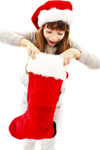 Little girl with Christmas gift on white background