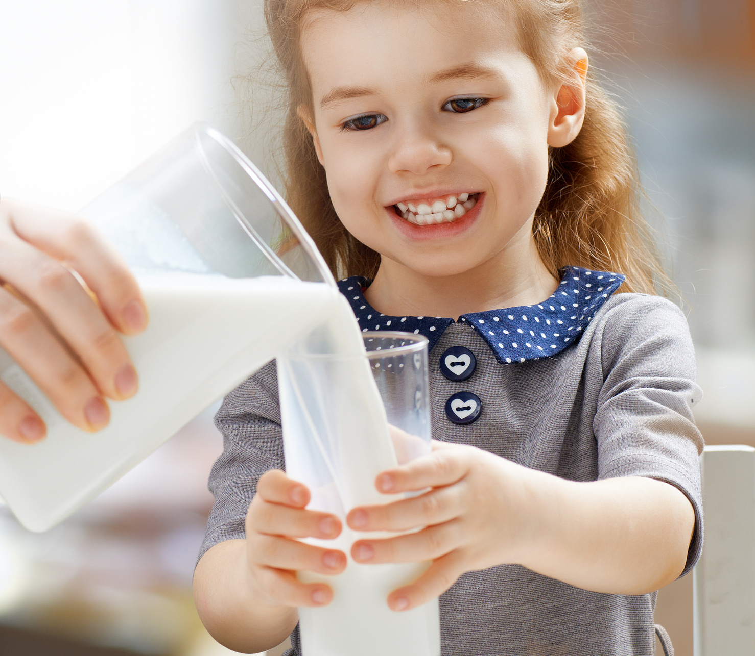 Milk poured into child's glass.