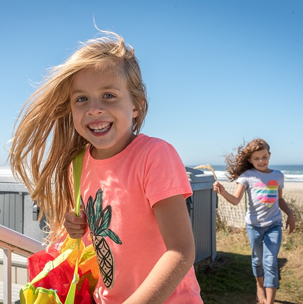 Little girl smiling for the camera to represent Smile Surfers' pediatric dentistry in Washington state