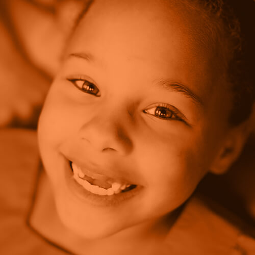 A smiling child to represent preventive care at Smile Surfers - clicking this photo will take you to our Services page
