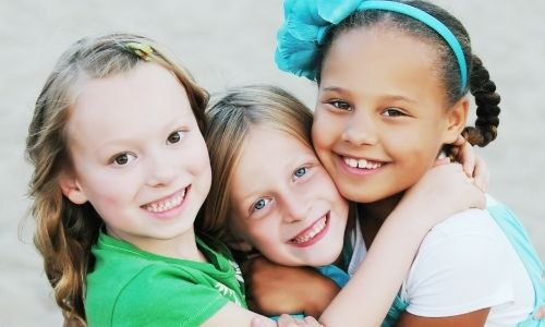 Three young girls who are patients of Smile Surfers Kids Dentistry